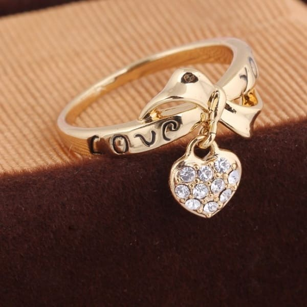 /E/n/Engagement-Ring-Rose-Gold-Plated-With-Heart--Shaped-White-Stones-4493392.jpg