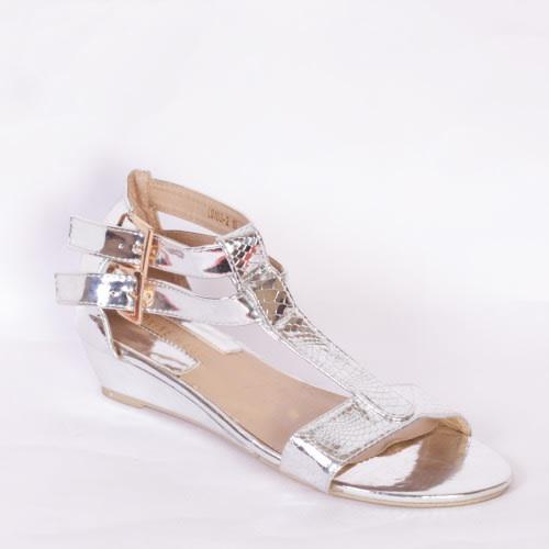 0e7c726f8c4c Nine West Ladies Silver Wedge Sandal.