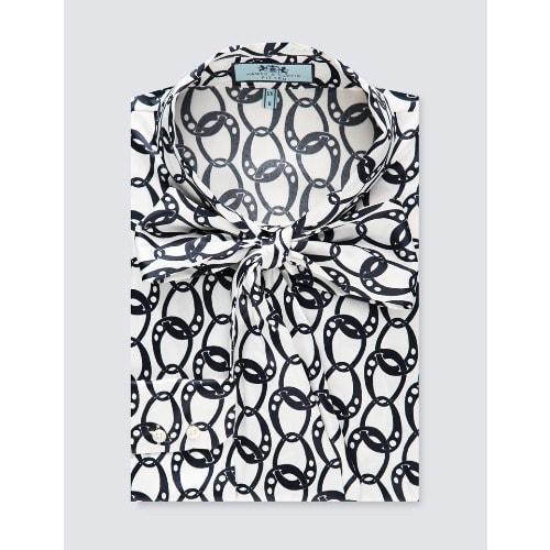 1b92d50ebd5bc0 Hawes & Curtis. Women's Cream & Blue 70s Chain Print Satin Fitted Shirt ...